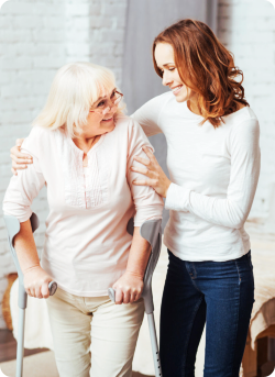 caregiver assisting the senior woman