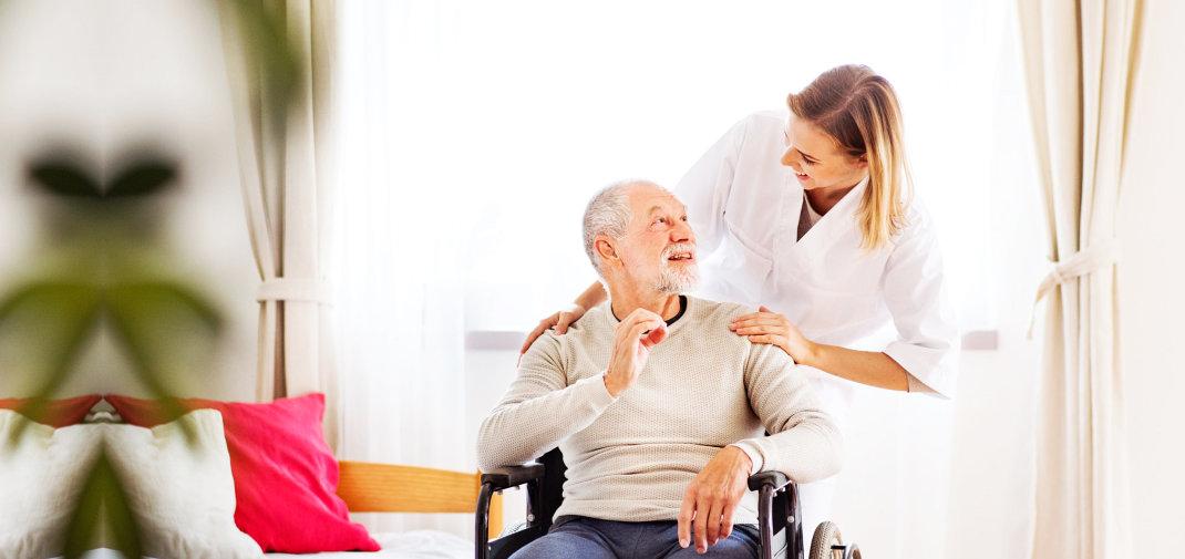 elderly man and caregiver