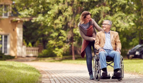 edlerly man in a wheelchair and his caregiver